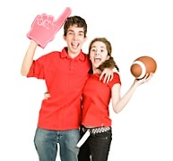 Two enthusiastic teen football fans jumping for joy. Full body isolated on white.